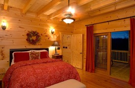 A Rolling River Cabin | Cabin Rentals of Georgia | Main Level Queen Suite